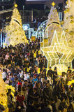 Holiday celebrations. People gathering to celebrate Christmas and New Year`s Eve at the public square near the Central World shopping mall in Bangkok, Thailand Royalty Free Stock Photos