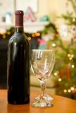 Holiday cheer. Red wine, two glasses and Christmas spirit: holiday cheer stock image
