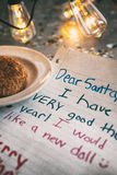 Holiday: Child Letter To Santa With Edison Bulbs Royalty Free Stock Photography
