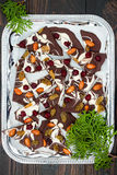Holiday chocolate bark with dried fruits and nuts on a dark wood background. Top view. Dessert recipe for judaic holiday Tu Bishva Stock Image