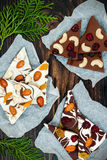 Holiday chocolate bark with dried fruits and nuts on a dark wood background. Top view. Dessert recipe for judaic holiday Tu Bishva Stock Photography