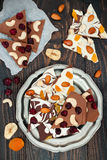 Holiday chocolate bark with dried fruits and nuts on a dark wood background. Top view. Dessert recipe for judaic holiday Tu Bishva Stock Images