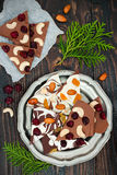 Holiday chocolate bark with dried fruits and nuts on a dark wood background. Top view. Dessert recipe for judaic holiday Tu Bishva Stock Photos