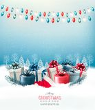 Holiday Christmas background with a gift boxes and a garland. Stock Images