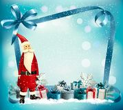 Holiday Christmas background with a gift boxes and Santa Claus. Stock Photography