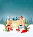 Holiday Christmas background with a gift boxes and Santa hat. Royalty Free Stock Images