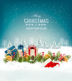 Holiday Christmas background with a gift boxes and Santa hat. Vector Stock Photography