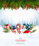 Holiday Christmas background with a gift boxes and Santa hat. Stock Photo