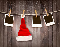 Holiday Christmas background with photos and a Santa hat. Royalty Free Stock Images