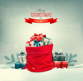 Holiday Christmas background with a sack full of gift boxes. Royalty Free Stock Photo
