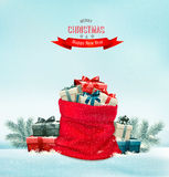 Holiday Christmas background with a sack full of gift boxes. Royalty Free Stock Images
