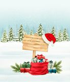Holiday Christmas background with a sack full of gift boxes. Royalty Free Stock Photography