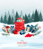 Holiday Christmas background with a sack full of gift boxes. Royalty Free Stock Image