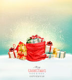 Holiday Christmas background with a sack full of gift boxes. Stock Photo
