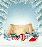 Holiday Christmas background with Santa Hat and a gift boxes Royalty Free Stock Image
