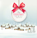 Holiday Christmas background with a village and  gift card. With a red bow. Vector Stock Photo