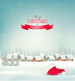Holiday Christmas background with a village and a santa hat. Stock Image