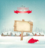 Holiday Christmas background with a village and a sign. Stock Photo