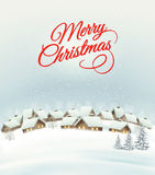 Holiday Christmas background with a village. Royalty Free Stock Image