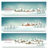 Holiday Christmas banners with villages. Stock Photos