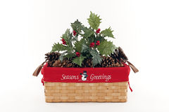 Holiday Christmas Basket. With Holly and Pine Cones Stock Images