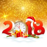 Christmas is coming. The holiday Christmas is coming. Volumetric digits 2018 and golden clock, gifts, spruce branches, in the snow. Fireworks on background Stock Photography
