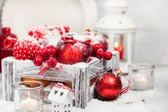 Christmas composition with red apples, balls, cinnamon, snow and Royalty Free Stock Images