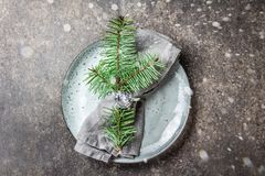 Holiday Christmas food background, cutlery, plate, napkin with ring and Christmas tree branch, table setting in silver Royalty Free Stock Photography