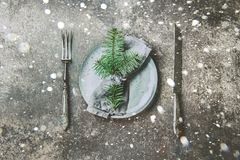 Holiday Christmas food background, cutlery, plate, napkin with ring and Christmas tree branch, table setting in silver Stock Photography