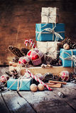 Holiday Christmas Gifts with Boxes, Twine, Balls, Fir Tree Toys. Holiday Christmas Gifts with Boxes, Twine, Balls, Pine Cones, Walnuts, Fir Tree Toys on Wooden royalty free stock image