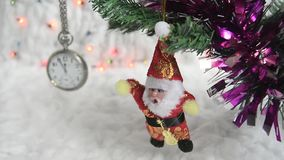 Holiday. Christmas and New Year Decoration. Abstract Blurred Bokeh Holiday Background With Silver Clock And Santa stock video footage