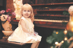 Holiday, christmas and people concept - charming little girl Stock Images