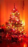 Holiday Christmas Tree. Photo of well decorated Christmas tree at night Stock Photography
