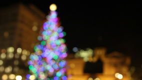 Holiday Christmas Tree with Festive Colorful Lights in Pioneer Courthouse Square with Historic Buildings at Night 1080p Royalty Free Stock Photo