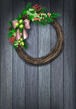 Holiday christmas wreath. Christmas Wreath. Evergreen holiday wreath with bow and red berries in circular shape on wood background. Vector illustration Stock Images