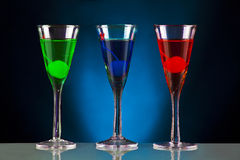 Holiday cocktails. Colourful holiday cocktails on a black and blue backgorund Stock Images