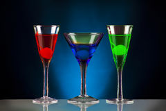 Holiday cocktails. Colourful holiday cocktails on a black and blue backgorund Royalty Free Stock Image