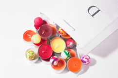 Holiday collection. Candles and small colorful balls Royalty Free Stock Photos