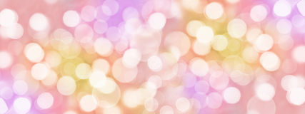 Holiday colorful background with blurred bokeh lights Stock Photos
