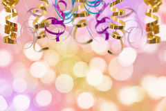 Holiday colorful background with ribbon and bokeh lights. Holiday colorful background with ribbon and blurred bokeh lights royalty free stock image