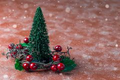 Holiday composition with christmas tree and wreath with holly be. Rries, snow effect, horizontal, copy space stock photography