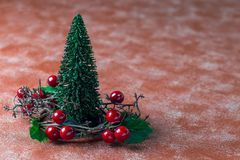 Holiday composition with christmas tree and wreath with holly be. Rries, horizontal, copy space royalty free stock images