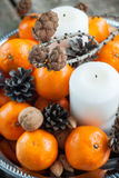Holiday Composition with Tangerines, Pine cones, holiday decorat Stock Images