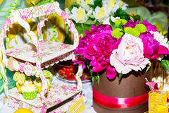 Holiday concept - close up on part of the festively decorated table with a beautiful bouquet of peonies, Stock Photos