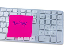 Holiday concept with computer keyboard and note with holiday. Royalty Free Stock Photo