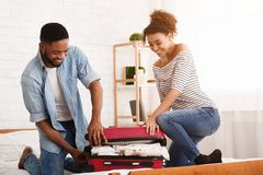 Holiday Concept. Couple Packing Suitcase For Vacation. In Bedroom royalty free stock images