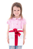 Holiday concept - cute little girl with gift box isolated on whi Royalty Free Stock Image