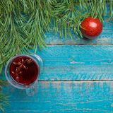 Christmas mulled wine. Holiday concept decorated with Fir branches, Cranberries and Spices. royalty free stock images