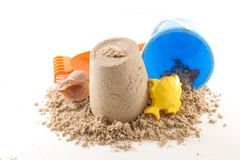 Holiday concept. Sand and baby toy Royalty Free Stock Photography