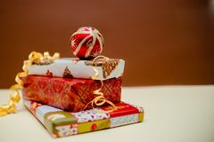 Holiday concept. Presents and christmas balls lying on each other. Green, red and golden colours.Top and side view.2019 new year. Christmas presents stock photography